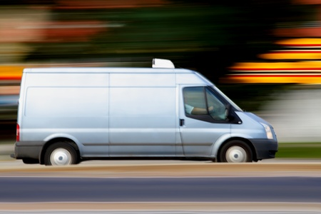 Speedy blue van always is  on time, panning and blur
