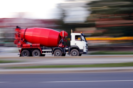 mixer: Blur red concrete mixer is going to build soon Stock Photo