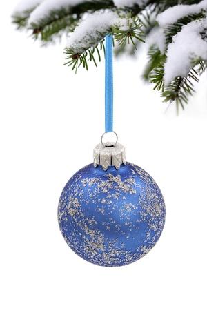 matt: Christmas evergreen spruce tree, glass ball and snow Stock Photo