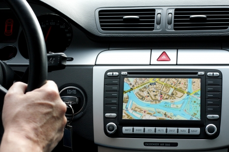 Car dashboard with gps panel, travel and technology background
