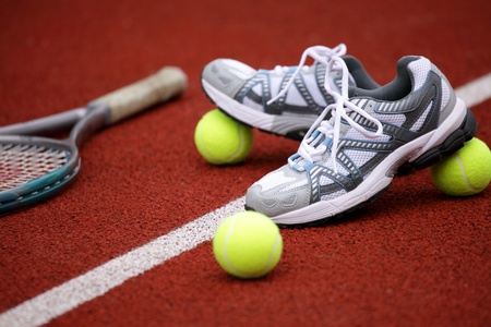 footing: Sports shoes for tennis on court background