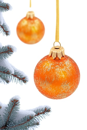 many christmas baubles: Christmas evergreen spruce tree and glass balls on snow background