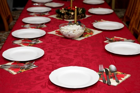 gold table cloth: Beautiful red table setting for Christmas, holiday background