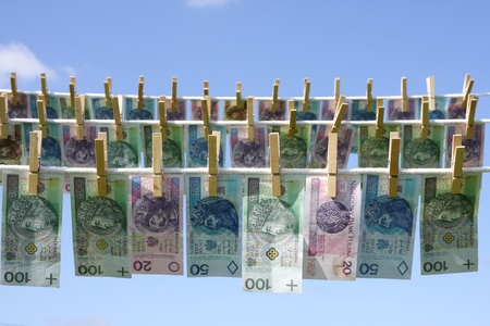 money laundering: Laundry money, polish money on a string of underwear