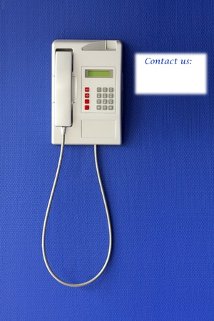 important phone call: Wall phone on blue background, phone concept
