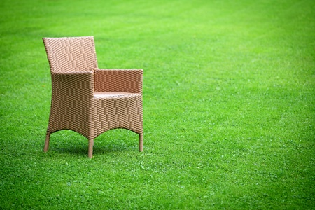 Empty chair in the middle of the lawn photo