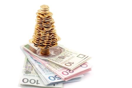 Christmas tree made of gold coins, Christmas tree made of polish gold coins, business metaphor photo