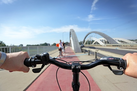 Red bicycle path and cyclist, motion blur