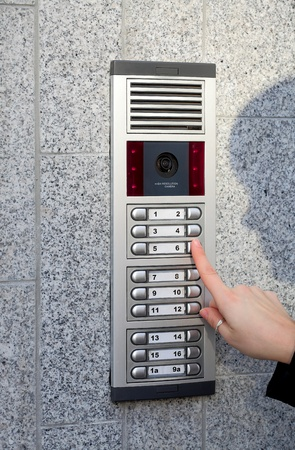 intercom: Video intercom in the entry of a house and stranger guest, technology and security background