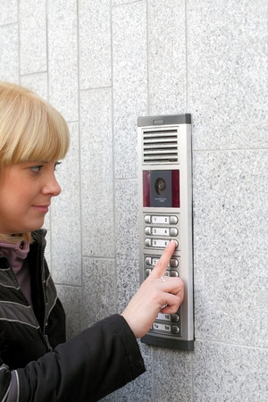 stranger: Video intercom in the entry of a house and stranger guest, technology and security background