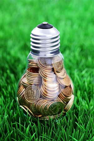 Traditional glass bulb and energy savings photo