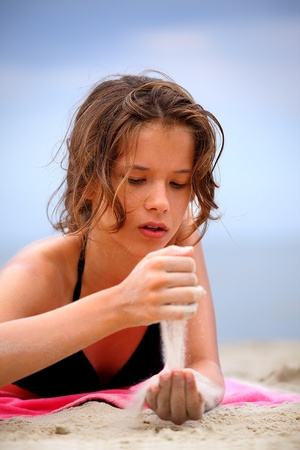 Summer vacation and view of  sea, beach, sand and beautiful teenager Stock Photo - 11835692