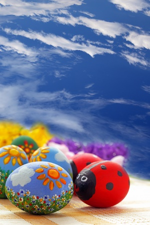 Easter eggs on blue sky background photo