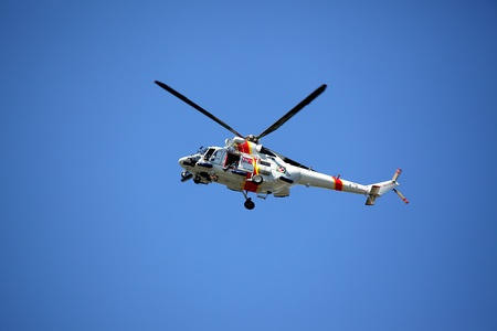 Border guard helicopter on blue sky