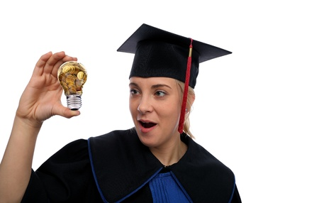 Beautiful girl in the graduation cap and glass bulb with golden coins in hand photo