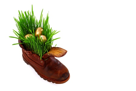 Easter and spring comes everywhere, even in the old soldier s boot Imagens