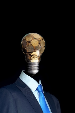 Elegant  businessman with head made by glass bulb full of coin photo
