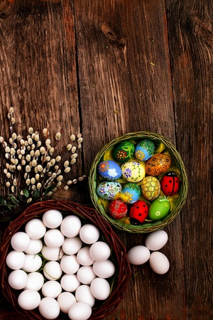 willow fruit basket: Easter eggs and  natural wooden country table, background and texture