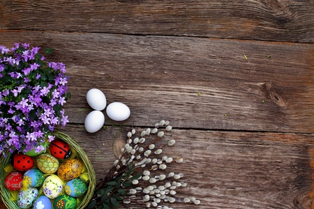 easter basket: Easter eggs and  natural wooden country table, background and texture