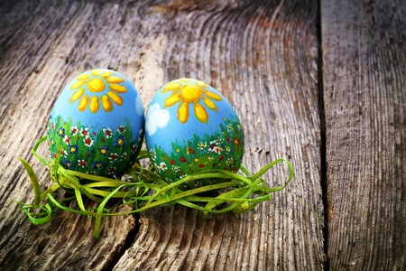 Easter eggs and  natural wooden country table, background and texture Stock Photo - 12593890