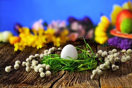 White easter egg on old farmhouse wooden table  photo