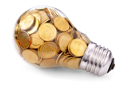 Traditional glass bulb with many golden coins Stock Photo - 13070137