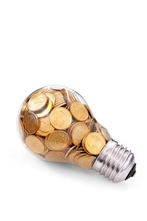 crisis economica: Ampolla de vidrio tradicional con muchas monedas de oro Foto de archivo
