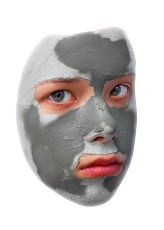 Sad teenager with grey cosmetic mask Stock Photo - 13294545