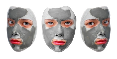 petrified fossil: Sad teenager with grey cosmetic mask Stock Photo