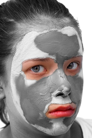 Sad teenager with grey cosmetic mask photo