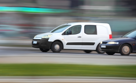 White minivan  on road in traffic jam, panning and blur, transport and business Stock Photo - 13714648