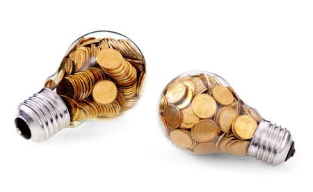 Traditional glass bulb with many golden coins photo