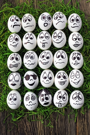 White eggs and  many funny faces photo