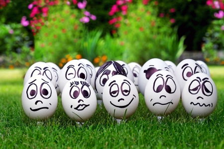 White eggs and  many funny faces, garden party photo