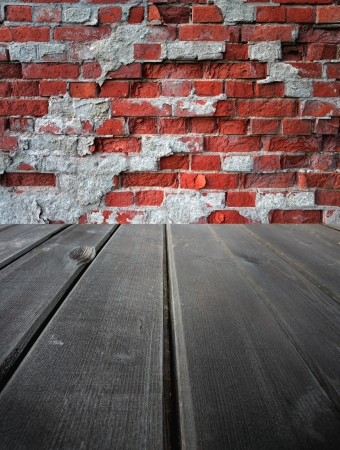 Old wooden  dark stage and an old brick wall, background photo