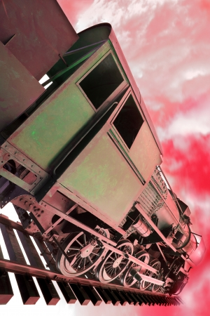 railway engine: Old train locomotive on the way to hell Stock Photo