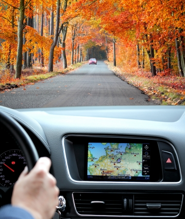 dash: Travel by car with gps in autumnal scenery