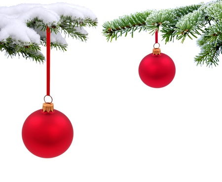 Christmas evergreen spruce tree with glass ball on snow background photo