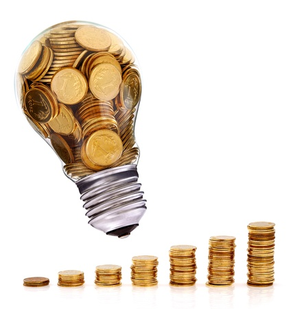 electricity prices: Traditional light glass bulb with many golden coins