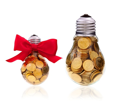 Traditional light glass bulb with many golden coins photo