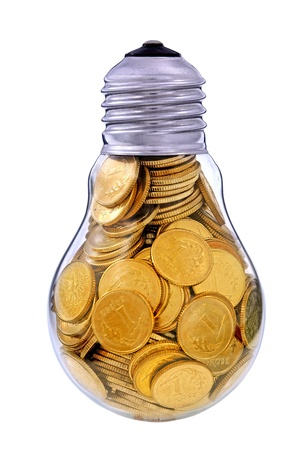 Traditional light glass bulb with many golden coins Stock Photo - 15384891