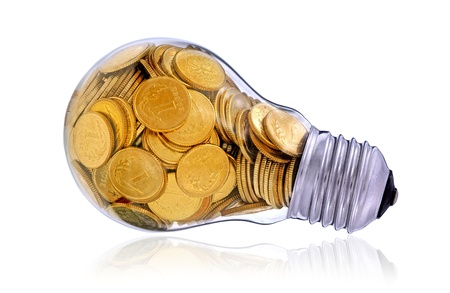 Traditional light glass bulb with many golden coins Stock Photo - 15384892