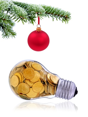 Christmas evergreen spruce tree and traditional  golden lightbulb on snow background photo