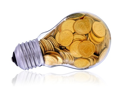 Golden  glass lightbulb  creative symbol  of  business, renewable energy sources Stock Photo - 16955766