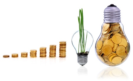 Golden  glass lightbulb  creative symbol  of  business, renewable energy sources Stock Photo - 16955784