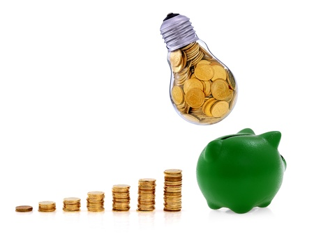 Traditional  lightbulb with  golden coins and green piggy bank, creative business symbols Stock Photo - 17247656