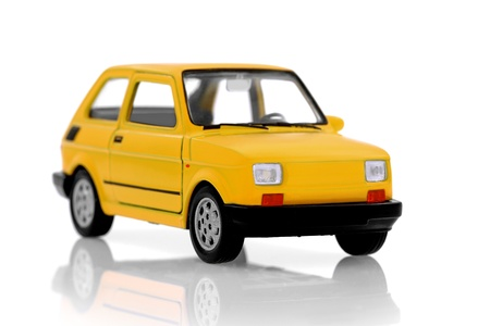 Cult small  yellow compact  city car on white photo