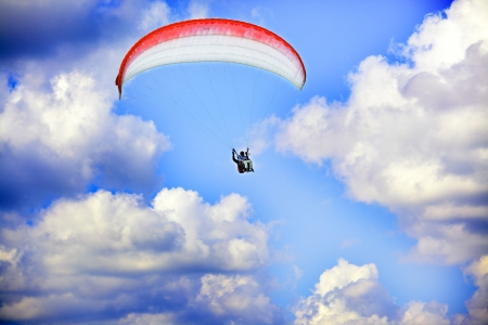 paraglide: Learning flying on paraglide, pilot and student in the air free as a birds Stock Photo