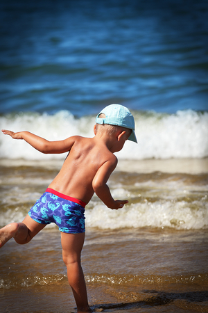 Little boy on vacation at the seaside Stock Photo - 26162120