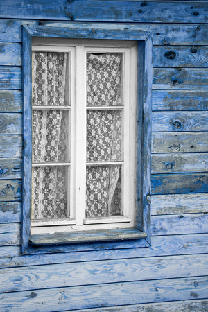 dowdy: Rural much neglected window in wooden wall of house, wooden background Stock Photo